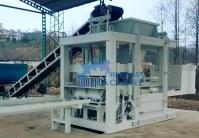 Machine manufacturing of cinder block, slabs, paved